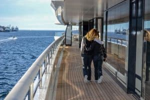 stewardesses walking along companionway of yacht