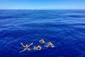 yacht crew swimming in the middle of the Atlantic Ocean