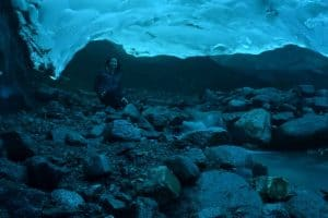 Image of Erin inside the Ice Cave under the Mendenhall Glacier in Juneau, Alaska
