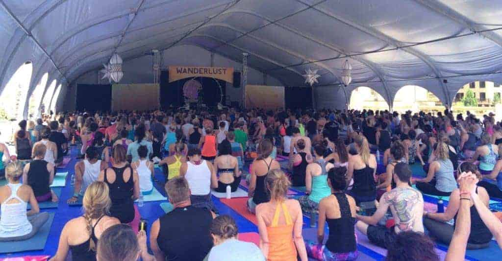 Image of Wanderlust festival yoga class in the best active holidays to take in 2017