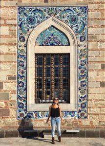 Curiously Erin standing in front of an ornate window of the Yali Mosque Izmir Turkey