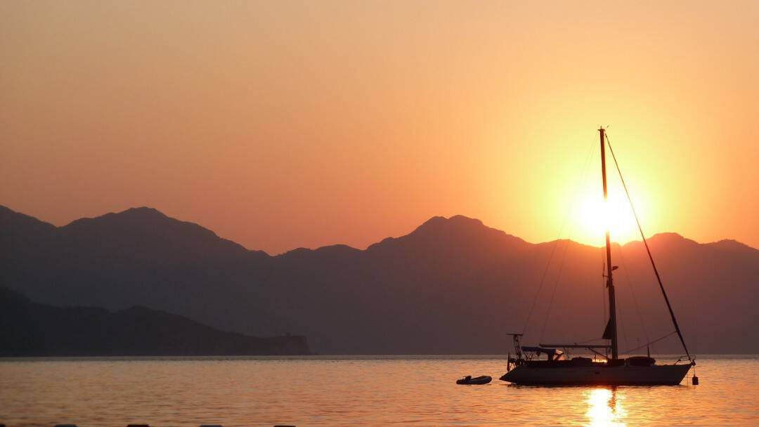 Sunset in Antalya Turkey with sailing boat