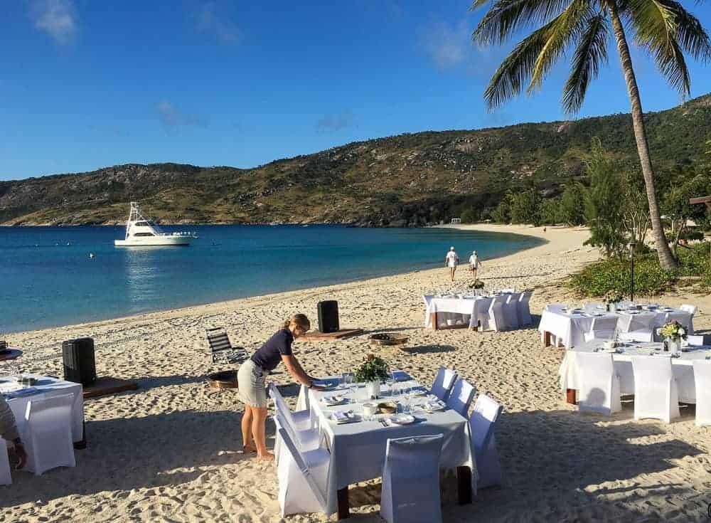 Island Jobs include hospitality work and setting beautiful beachside dinners