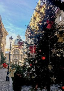 Bucharest in winter with Christmas tree in foreground and CEC Palace Bank
