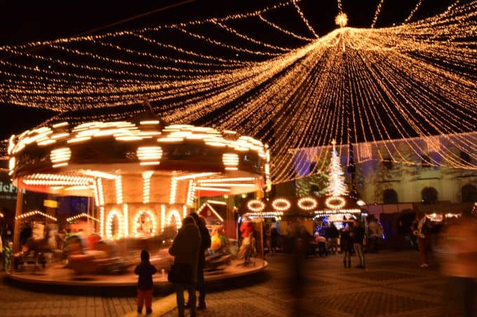 Christmas markets in Romania with carousel and fairy lights