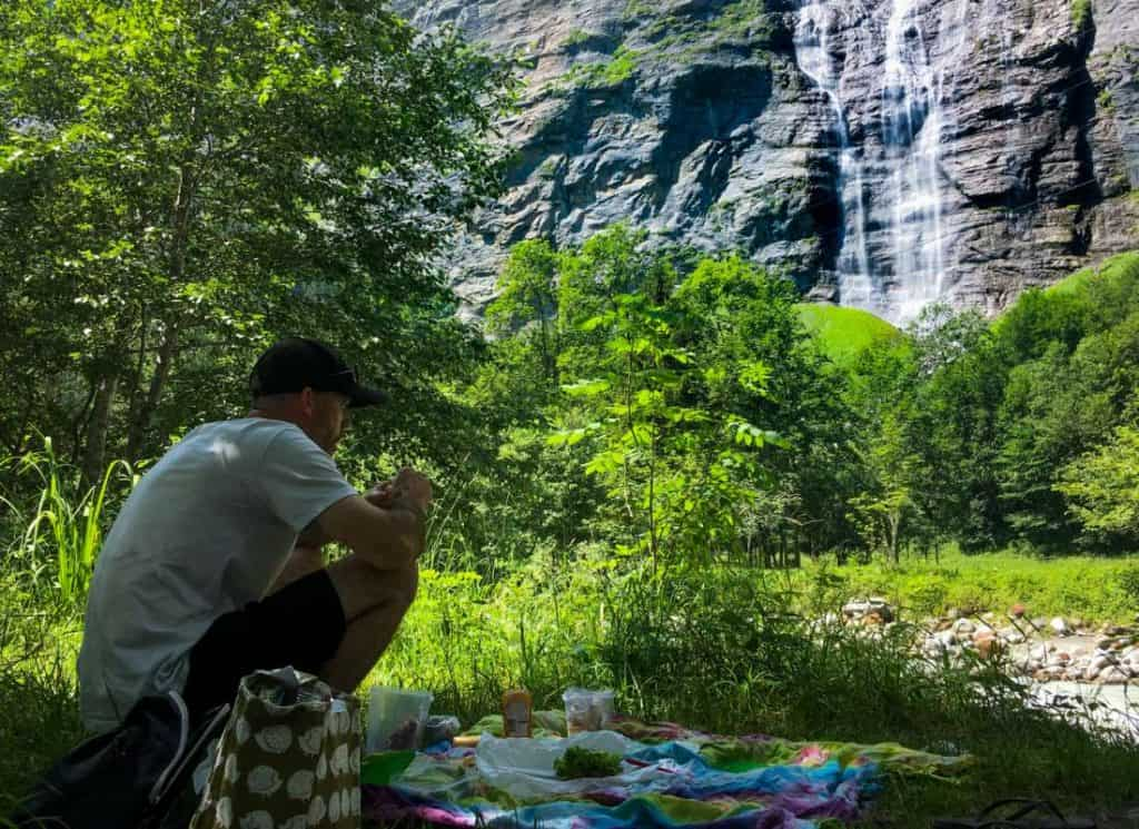 Travel Europe Cheap by Picnic in front of waterfall