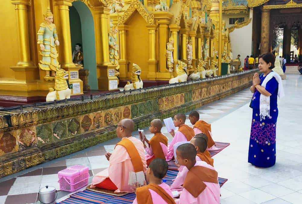 Nuns praying at the Shwedagon pagoda