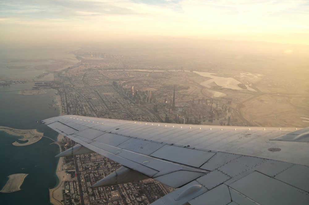 flying over a city aeroplane wing