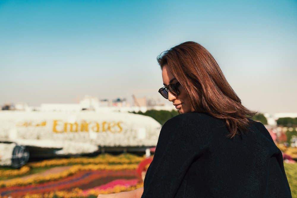 woman and emirates aeroplane
